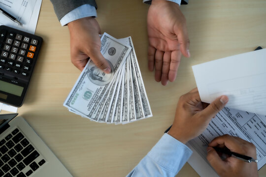 man dollars money corruption analysing growth profit financial trade funds and currency exchange United States Dollars corruption concept