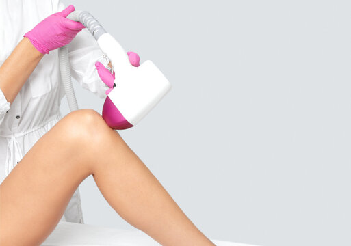 Elos epilation hair removal procedure on a woman's body. Beautician doing laser rejuvenation in a beauty salon. Removing unwanted body hair. Hardware ipl cosmetology