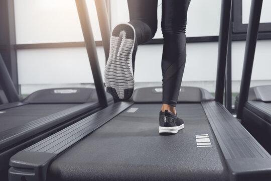 Legs woman running on treadmill.