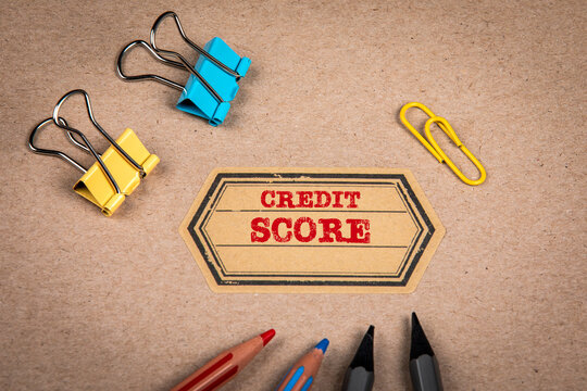 Credit Score. Cardboard notebook cover and colored pencils