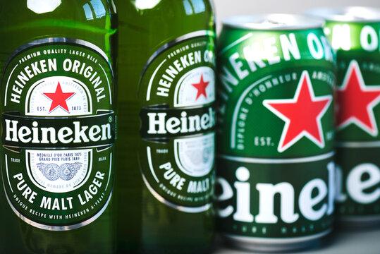 Heineken lager beer bottles and Heineken beer aluminum cans