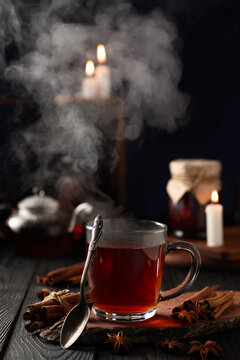 still life with hot tea in a glass and hot steam rising from the glass