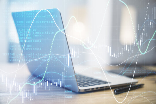Business stock market analytics concept with financial graphs, diagram and numbers on digital screen at laptop background