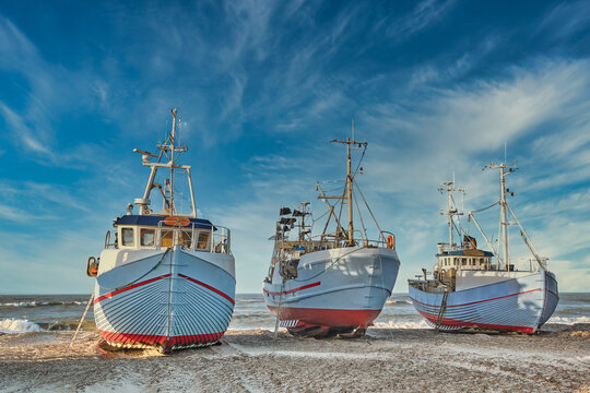 Coastal fishing boats vessels at Thorup beach in Western Denmark