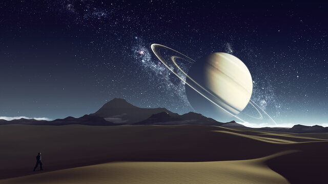 desert planet with explorer and saturn at the horizon