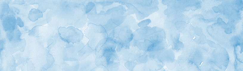 Pastel light blue watercolor painted background, blotches and blobs of paint and watercolor paper texture grain, abstract blue painting