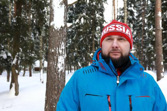 Portrait of man posing in winter park