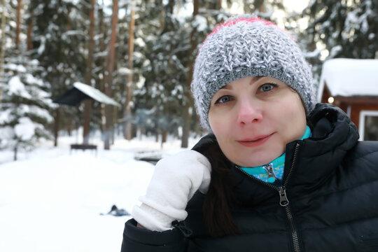 Portrait of woman in winter park