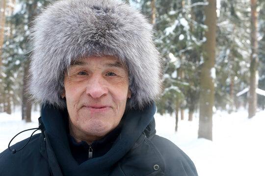 Senior man in fur hat
