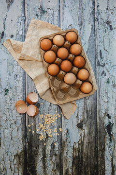 Cardboard carton with free range eggs on a rustic table