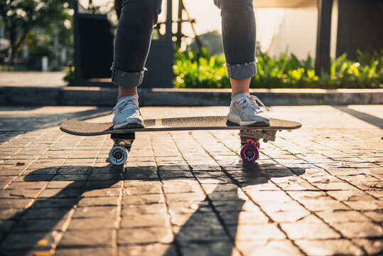 Close-up leg on surf skate or skateboard on the road, Sport activity lifestyle concept, Healthy and exercise.