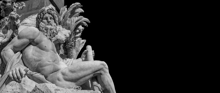 Greek or Roman God. Marble statue of River Ganges statue from baroque Fountain of Four River, erected in the 17th century in the historic center of Rome (Black and White with copy space)