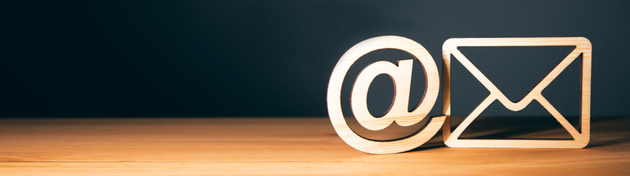 wooden letter with email sign