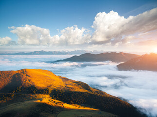 Wall Mural - Morning view of the alpine valley in fog. Location place Seceda peak, Dolomite alps, Italy, Europe.