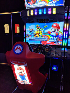 Mario Kart Arcade GP DX Cabinet unit on for play at Lucky Strike