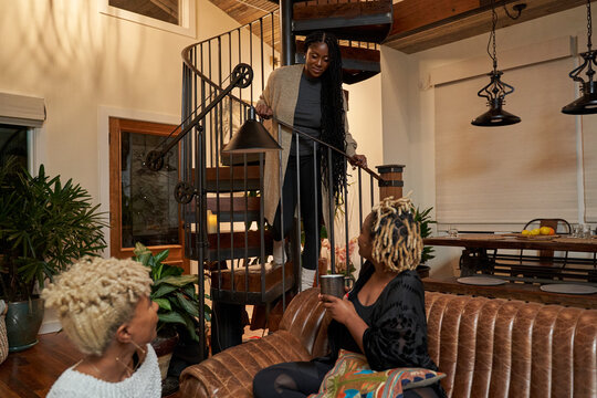 Black girlfriends talking at home during cozy self care retreat
