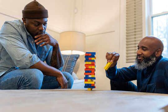 African American gay couple has game night at home