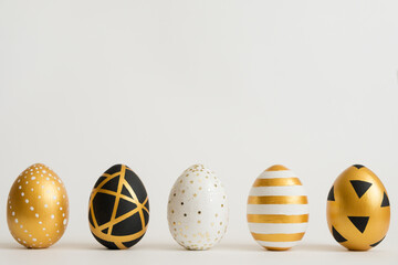 Easter golden decorated eggs stand in a row on white background. Minimal easter concept. Happy Easter card with copy space for text. Top view, flatlay.