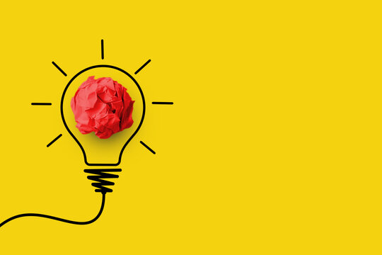 Creative thinking ideas and innovation concept. Paper scrap ball red colour with light bulb symbol on yellow background