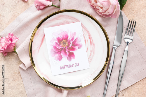 Beautiful table setting for Mother's Day on color background