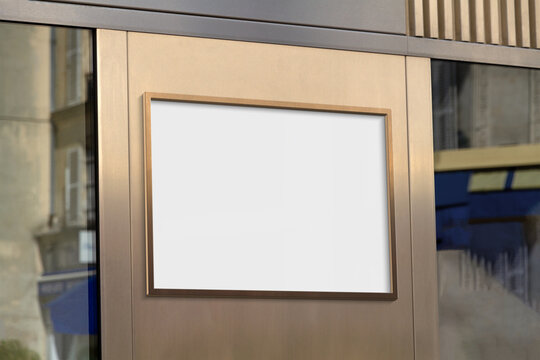 Metal frame hanging in street mockup. Template of a billboard on a wall bathed in sunlight 3D rendering