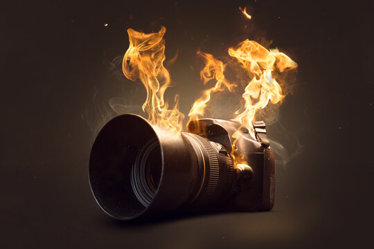 Camera on fire burning with actual flames