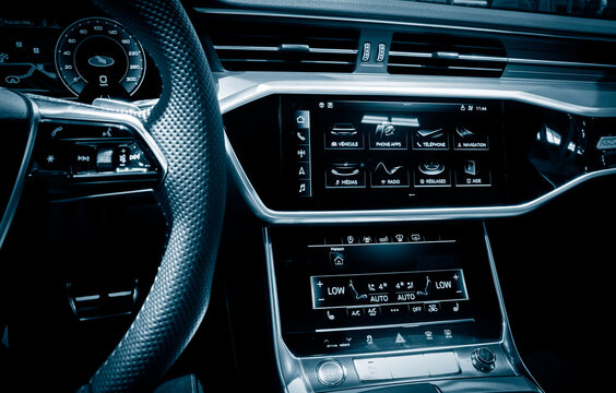 Driver view of the new Audi A6 car interior dashboard.