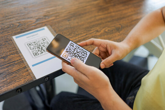 Qr code payment. E wallet. Man scanning tag accepted generate digital pay without money.scanning QR code online shopping cashless payment and verification.technology concept
