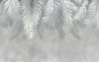 Tropikalne liście na szarej ścianie