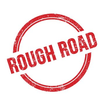 ROUGH ROAD text written on red grungy round stamp.