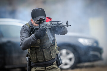 Military army soldier in action tactical combat shooting from rifle machine gun. Shooting and weapons. Outdoor shooting range