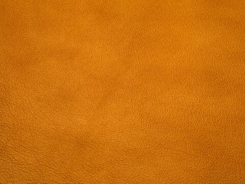Orange cattle leather texture background