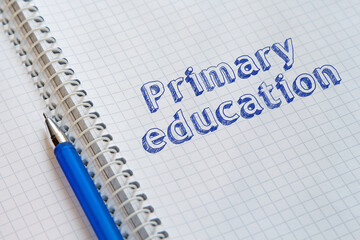 Text Primary education handwritten on sheet of notebook
