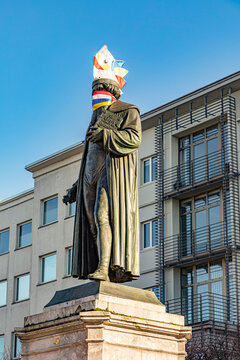 statue of Johannes Gutenberg dressed with a carnival cap and mask in Mainz