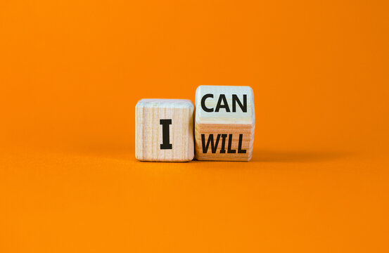 I can and will symbol. Turned a wooden cube and changed words i can to i will. Beautiful orange background, copy space. Business, motivational and i can and will concept.