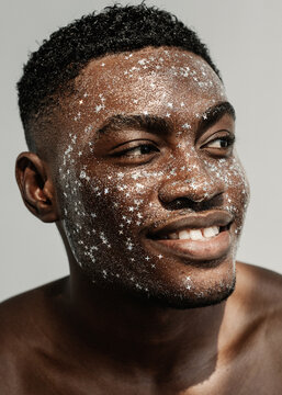 Portrait of a smiling man with glitter on his face