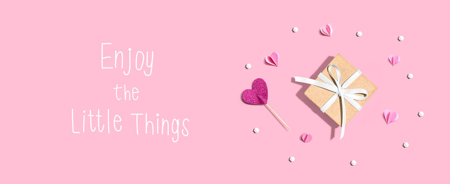 Enjoy the little things message with a small gift box and paper hearts