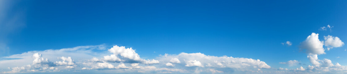 Panoramic fluffy cloud in the blue sky. Sky with cloud on a sunny day.