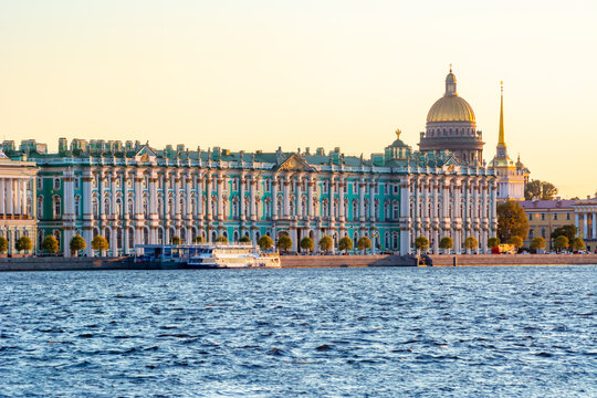 Saint Petersburg cityscape with St. Isaac's Cathedral dome and Hermitage museum at sunset, Russia
