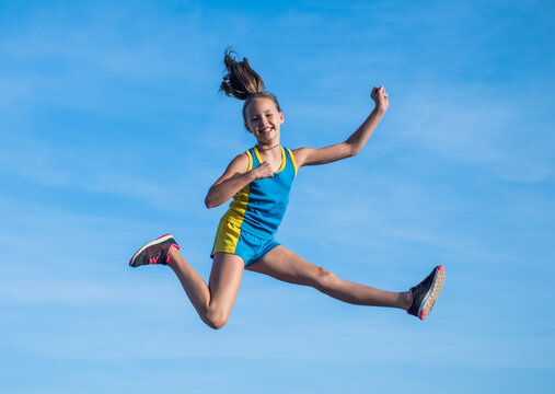 Young and free. future of sport. outdoor activity. workout in morning. healthy child jumping outdoor. fitness kid wear sportswear. full of energy. teenage girl feel freedom. happy childhood