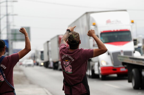 People supports drivers of trailer trucks during in a caravan to protest against the Yaqui indigenous roadblocks in the state of Sonora, that are affecting the trade with the U.S. according to local media, in Monterrey