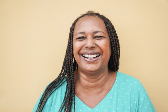 Happy senior african woman looking at camera - Focus on face