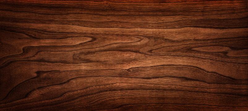 Walnut tree texture close up. Wide walnut wood texture background. Walnut veneer is used in luxury finishes.