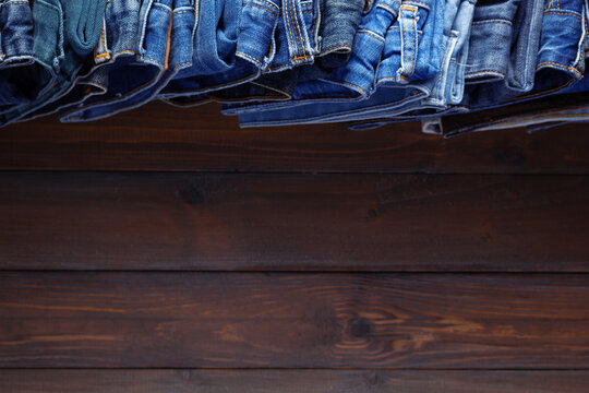 Denim jeans on old wooden background texture table surface