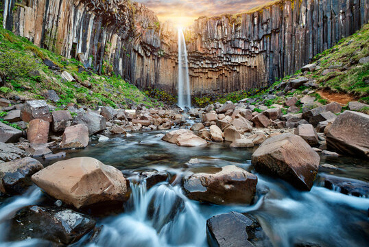 Famous Svartifoss Waterfall. Colorful summer scene in Skaftafell, Vatnajokull National Park, Iceland, Europe.