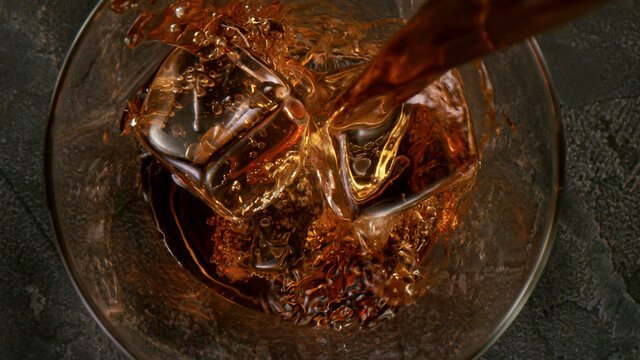 Ice Cube falling into Glass of Whisky, Top Shot, Freeze Motion.