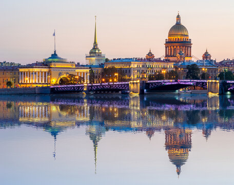 Saint Petersburg cityscape with St. Isaac's cathedral, Admiralty building and Palace bridge at sunset reflected in Neva river, Russia