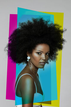 Attractive Afro woman with primary colors against white background