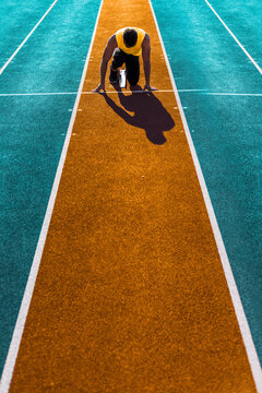 Athlete kneeling on starting line