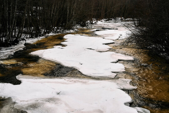 Lenaelva River at Toten, Norway, in early spring.